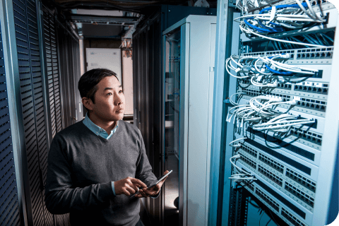 A man standing in a server room